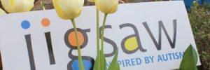 Jigsaw logo with tulips