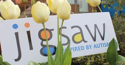 Jigsaw logo with tulips